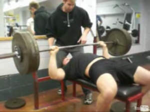 Jason Crowley - benching 327 pounds.